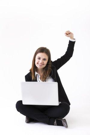 Stylish Businesswoman using a laptop
