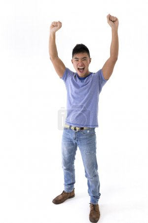Chinese man celebrating with his arms up