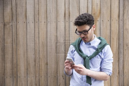 man using a smartphone outdoors