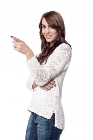 Photo for Young woman pointing index finger at something - Royalty Free Image