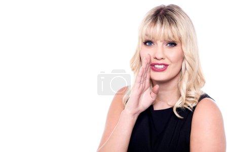 Beautiful woman whispering a secret
