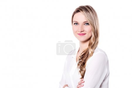 Photo for Young beautiful smiling woman posing with arms folded - Royalty Free Image