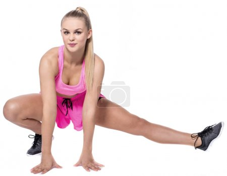 sporty woman doing stretching exercises