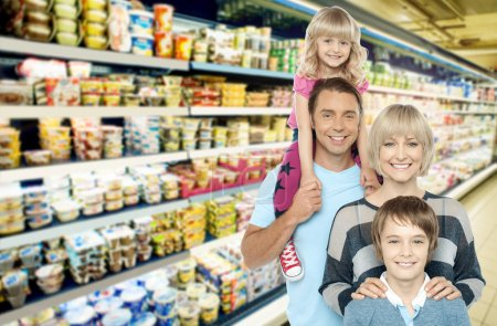 Photo for Image of young family shopping for groceries in supermarket - Royalty Free Image
