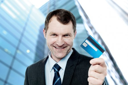 businessman offering credit card