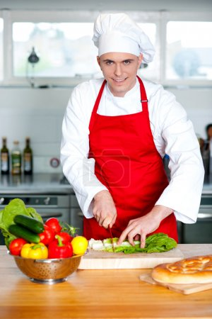 Male chef chopping vegetables