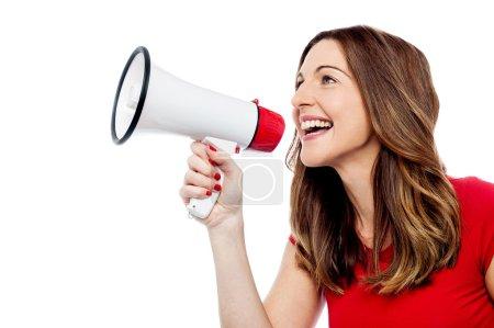 Happy woman holding megaphone