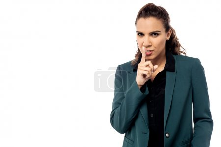 Serious business woman making silence sign