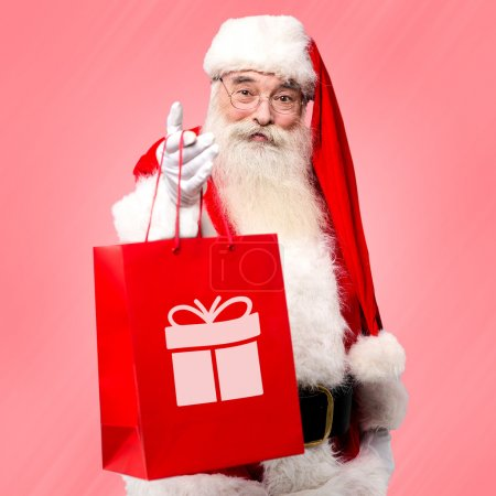 Photo for Santa claus distributing gifts to all on Christmas eve - Royalty Free Image