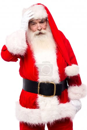 Photo for Worried santa claus holding hand on his forehead, isolated on white - Royalty Free Image