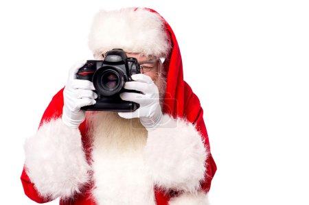 Santa claus taking picture