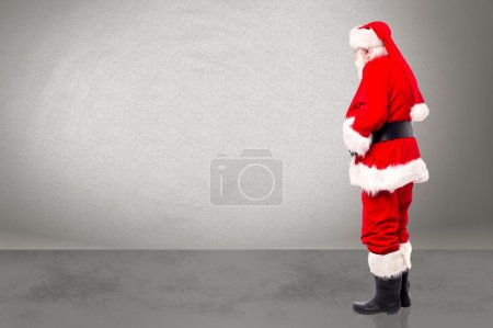 Photo for Santa claus standing and looking at something - Royalty Free Image