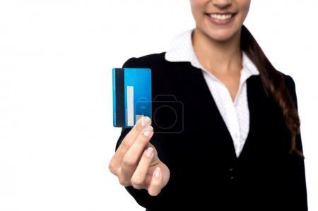 Female executive showing debit card