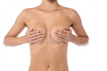 woman covers her breasts with hands