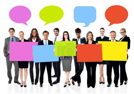 Photo for Business people with colorful boards and speech bubbles above - Royalty Free Image