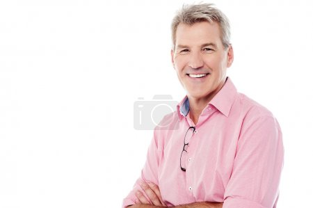 Photo for Mature casual man posing with crossed arms isolated on white - Royalty Free Image