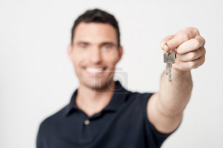 Real estate agent showing key