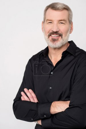 Photo for Handsome mature man posing with folded arms - Royalty Free Image