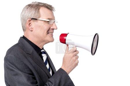 businessman talking on megaphone