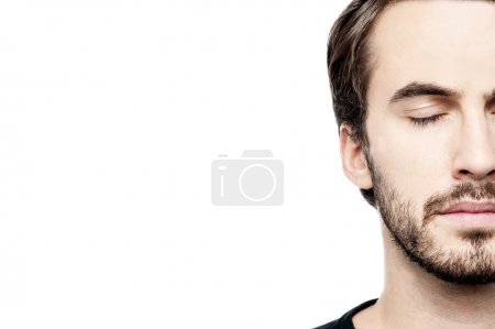 Photo for Ropped image of young man face over white - Royalty Free Image