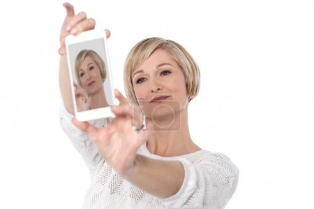 Woman taking selfie with smartphone