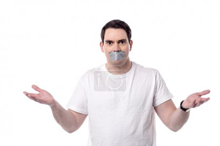 Photo for Casual man with mouth covered by masking tape - Royalty Free Image