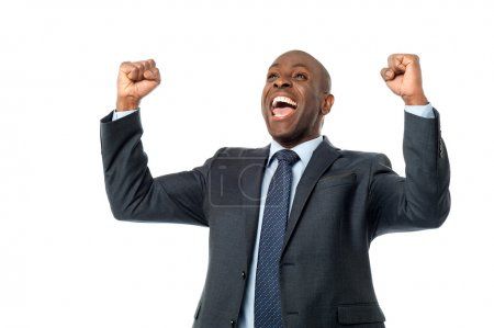 Foto de Successful male entrepreneur clenching his fists over white - Imagen libre de derechos