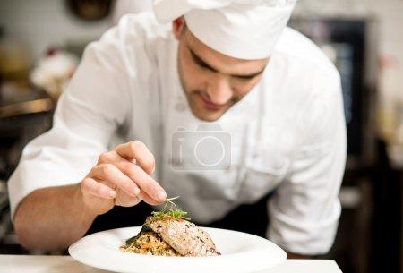 chef making grilled tuna fish