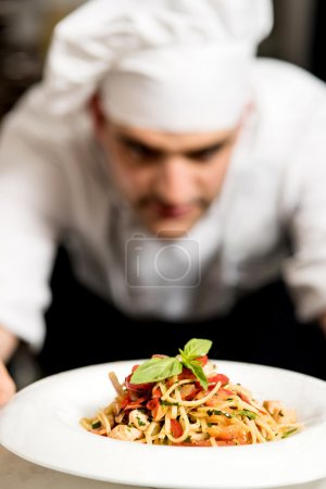 chef looking at pasta salad