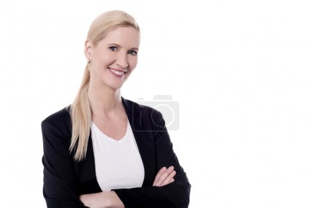 Photo for Beautiful woman posing with folded arms - Royalty Free Image