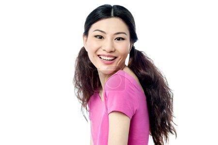 Cheerful girl looking at camera