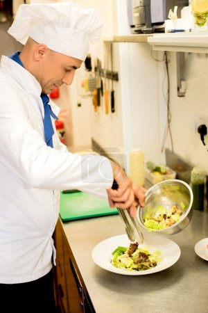 salad decorated by male chef
