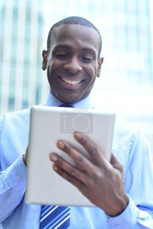 businessman working in his digital tablet