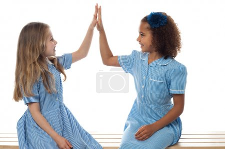 School students giving high five