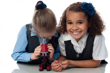 School girls working with a microscope