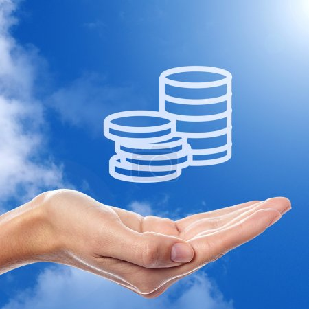 Photo for Save your earnings icon on hand with blue sky in background - Royalty Free Image