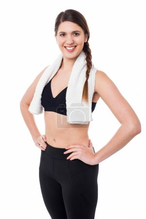 Photo for Pretty athletic woman with hands on waist isolated on white - Royalty Free Image