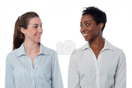 Photo for Two businesswomen looking at each other isolated on white - Royalty Free Image