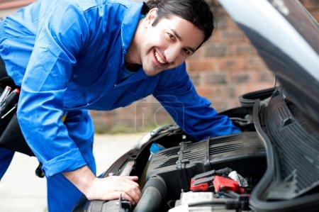 Mechanic fixing car bonnet