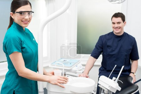 Orthodontist with female assistant
