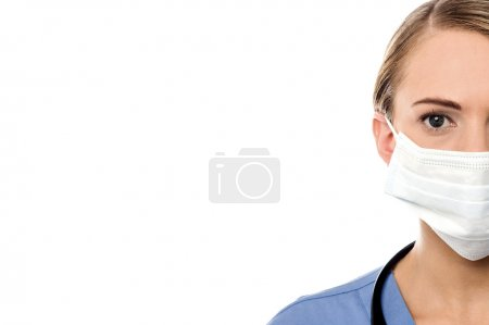 female surgeon with surgical mask