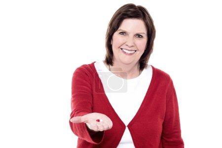 Senior woman lending something