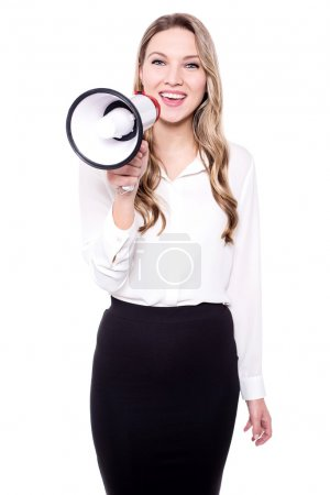 Pretty businesswoman with a megaphone
