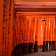 Red tunnel with japanese  hieroglyphs on walls...