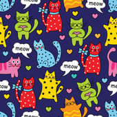 Cartoon seamless multicolored cats and hearts on a blue background