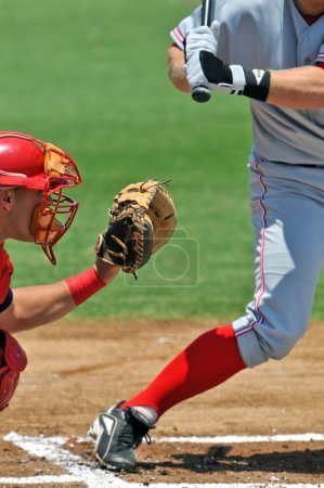 baseball batter and catcher wait for pitch