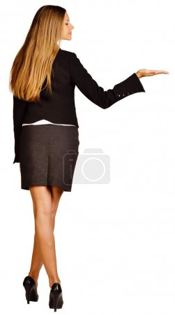 Business woman holds in her hand raised and looks at it.