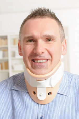 Man in cervical collar