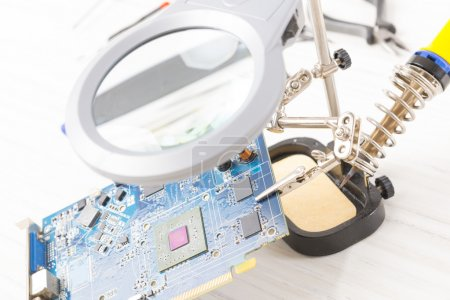Photo for Electronic PCB mounted on the third hand tool - Royalty Free Image