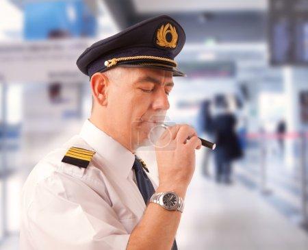Airline pilot with e-cigarette
